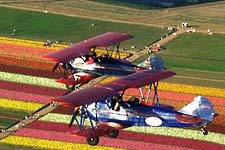 An open cockpit biplane ride over the flower fields. Courtesy of the Carlsbad Convention & Visitors Bureau