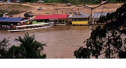 Copyright Margaret Deefholts. The view from the Taman Negara Resort includes the brown waters of the Tembeling River and the small village of Kuala Tahan Kampung.
