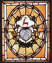 Used with permissions. A stained-glass window depicting the Boldt family coat of arms.