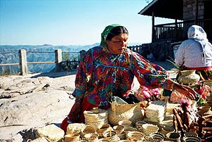 A Raramuri woman sells handmade crafts at the Divisadero overlook above the Copper Canyon. Copyright: Kathryn Means.
