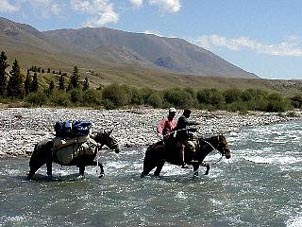 Crossing the Tekes River, Tien Shan. Copyright: Rick Hudson.