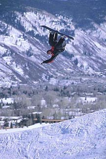 A snowboarder boosts out of the halfpipe at Buttermilk. Copyright: Rob Gracie.