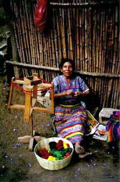 Lidia's mother winds a ball of thread. The weaving tradition is earned at an early and is handed down from generation to generation. Copyright: Kennerley Clay.