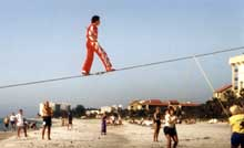 Tino Wallenda begins his high wire beach walk on Longboat Key, Florida. © by James Priest